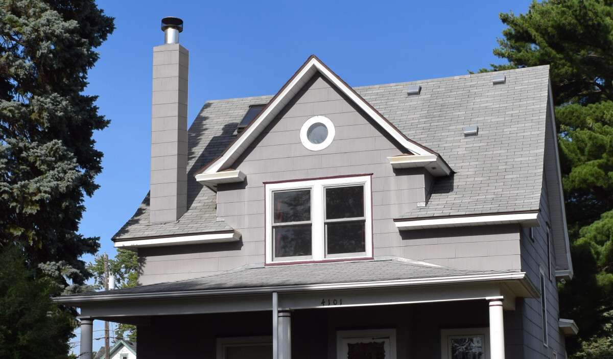 A mockup of the chimney with matching siding