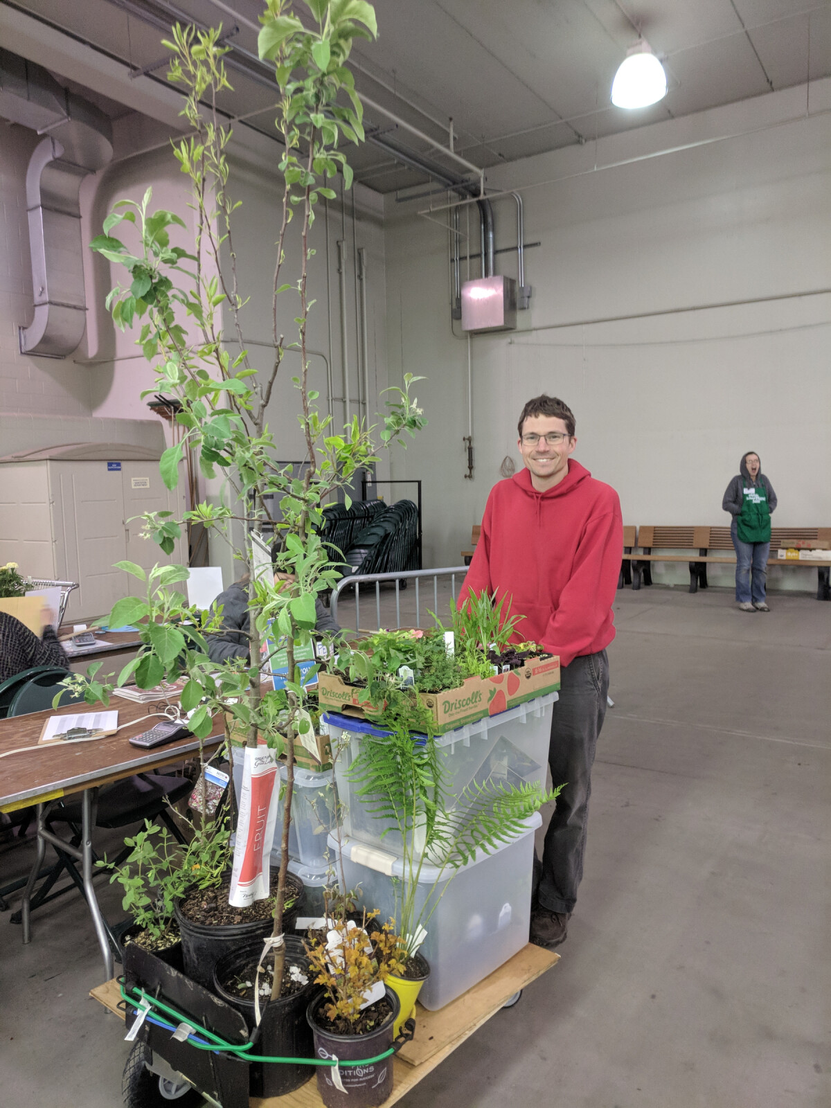 Ian with a cart overloaded with plants